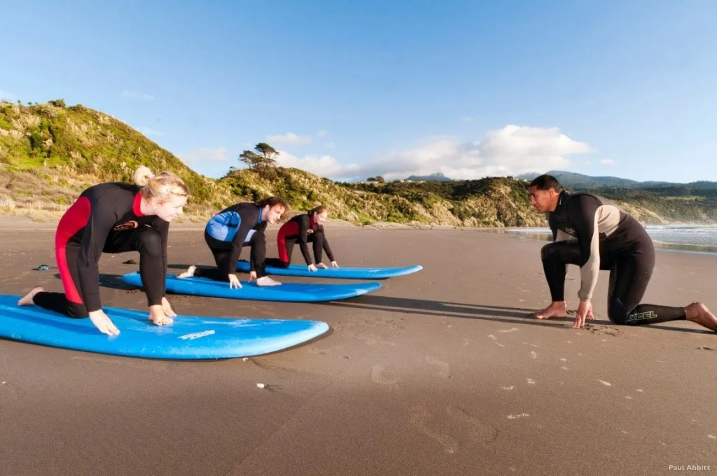 Surf lessons in Raglan New Zealand by Tourism New Zealand