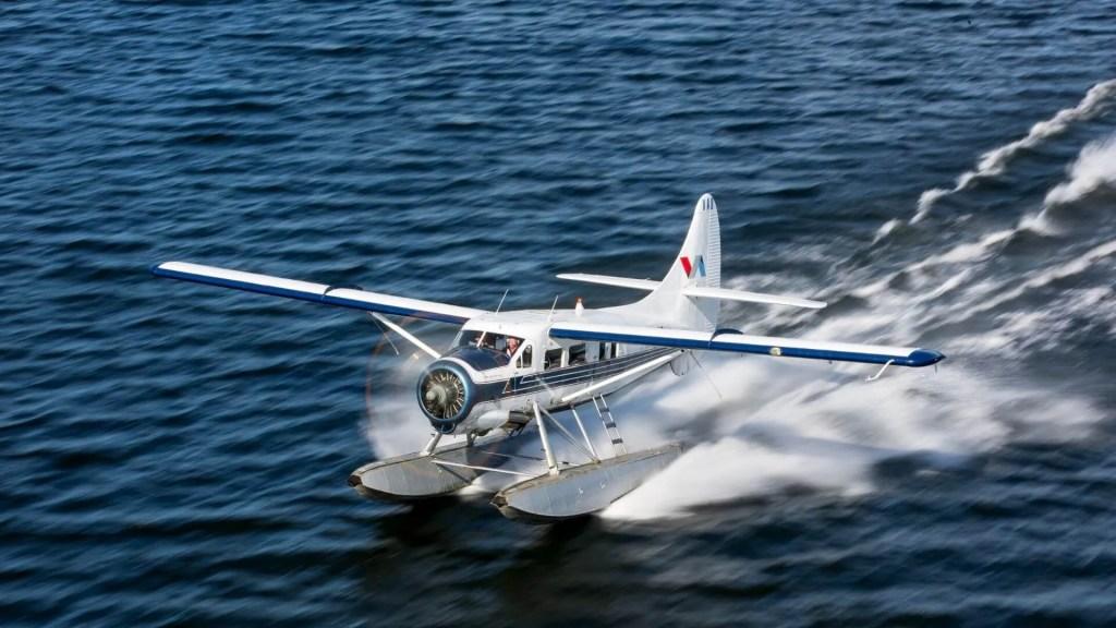Floatplane landing on water by Volcanic Air Rotorua