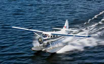 Floatplane landing on water by Volcanic Air Rotorua