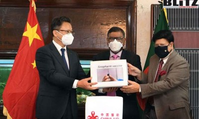 Bangladesh Foreign Minister AK Abdul Momen, Prime Minister Sheikh Hasina, Covax, Chinese Foreign Minister Wang Yi, Sinopharm vaccine