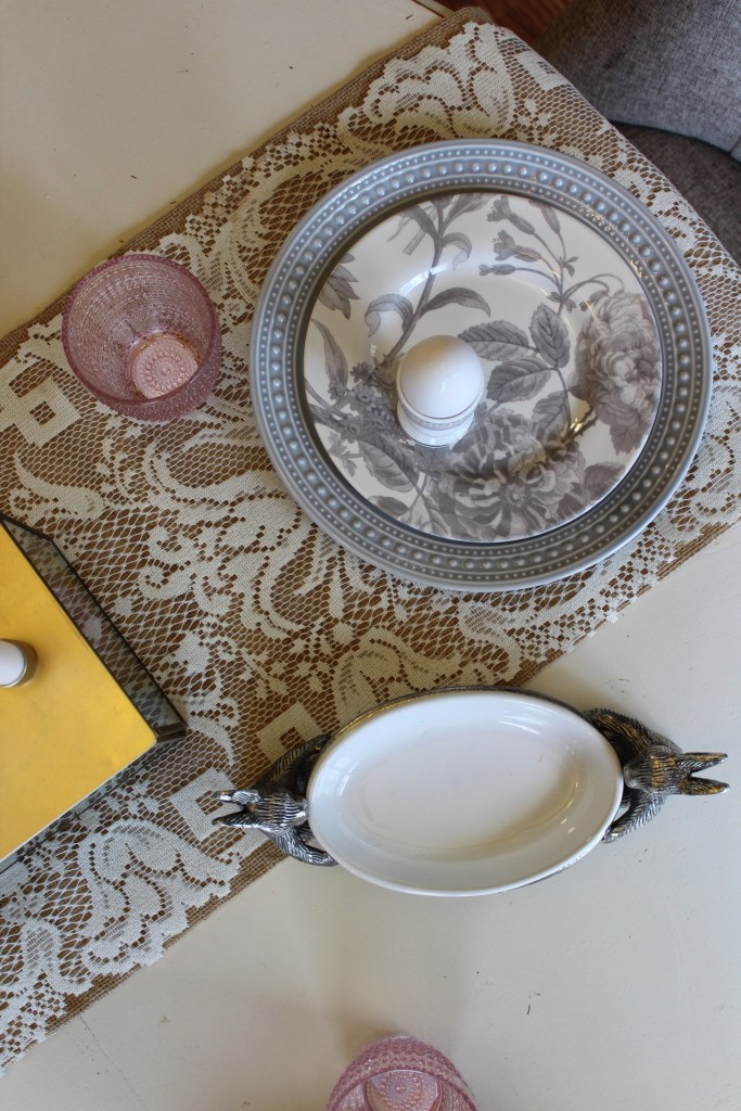 gray and pink plates and Easter table setting.