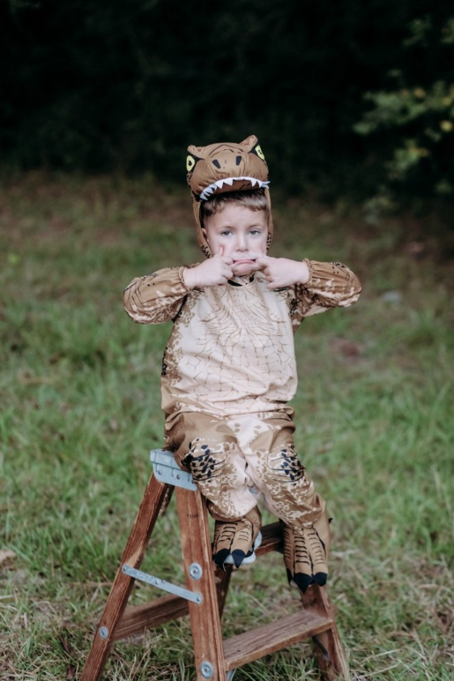 Little boy dressed as a velociraptor from Jurassic Park