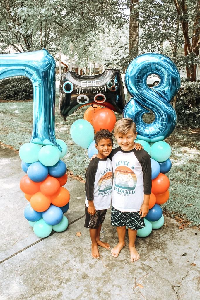 Birthday boys with balloon columns