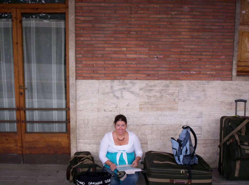 Tiffany waiting for the train in Italy