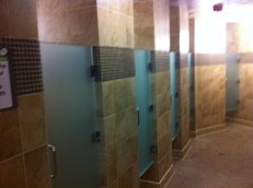 Showers in the men's locker room at 24 Hour Fitness