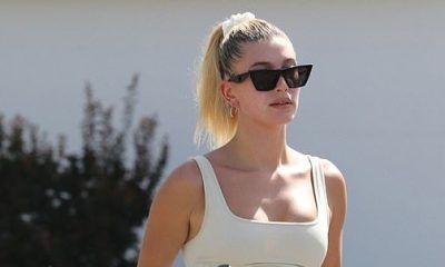 Hailey Baldwin models a crop top as she leaves a Hot Pilates class... after wearing a shirt made by her husband Justin Bieber