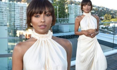Kat Graham flashes a hint of her toned abs in cream co-ords as she attends ...
