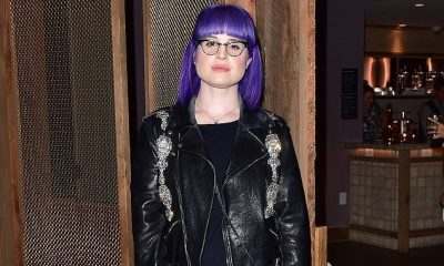 Kelly Osbourne continues to show off her bright purple locks as she dons a quirky biker jacket and jeans at a hotel opening in West Hollywood