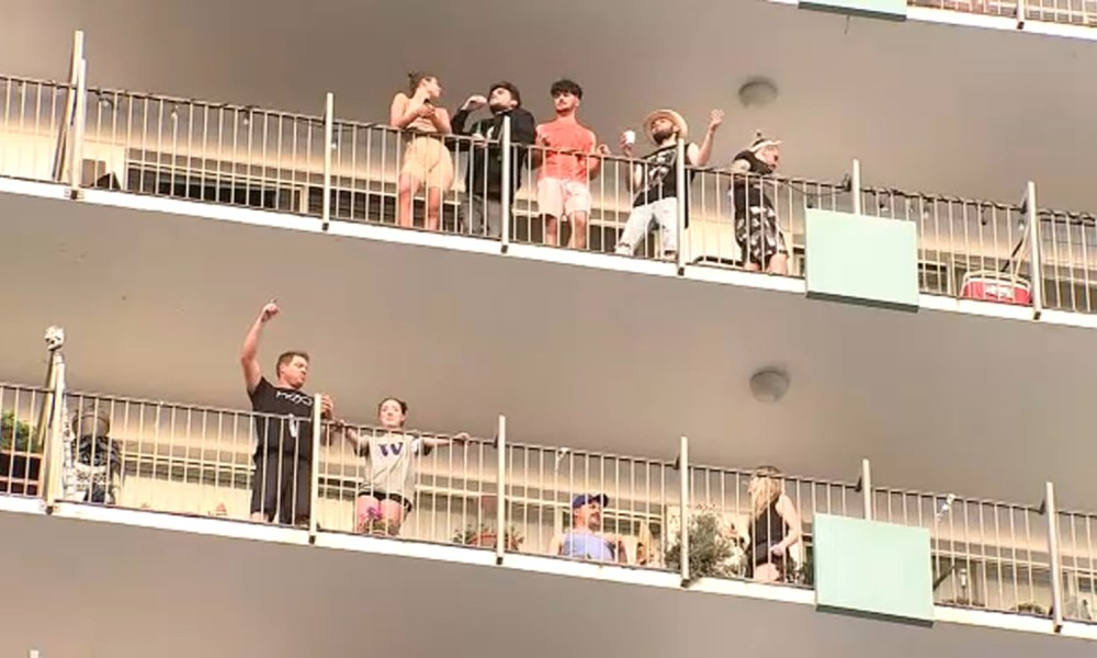 Residents of Hollywood apartment complex hold dance party from their windows, balconies