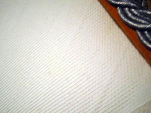 Variante de tejido de una tunica blanca