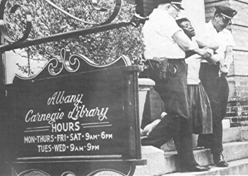 """Student arrested for trying to read a book in a """"white only"""" library in Albany, Georgia, 1963."""