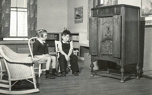 Kids listening to the radio. Or perhaps an armoire.