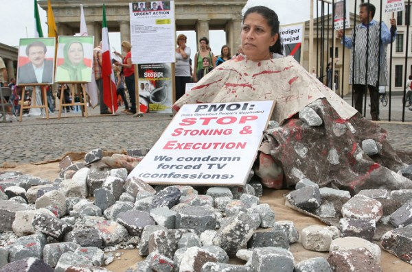 A woman protests stoning at a demonstration in Berlin