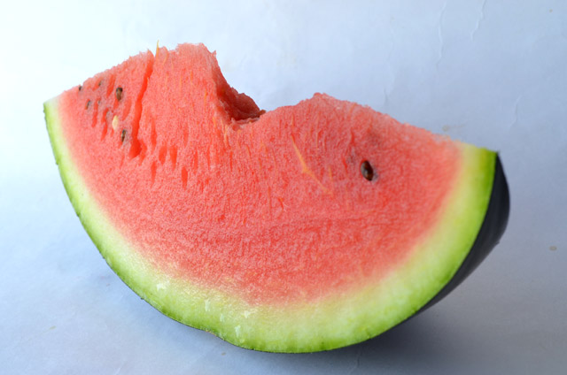 Slice of watermelon with a bite missing