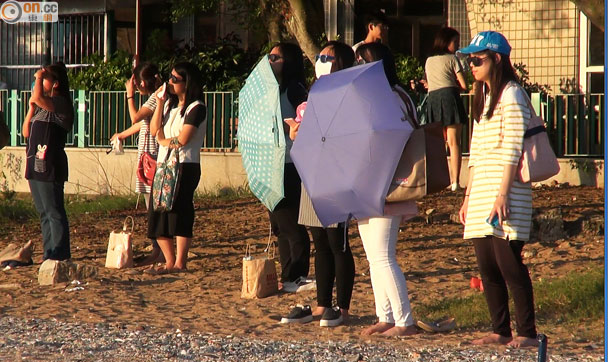 Sun dieters with umbrellas