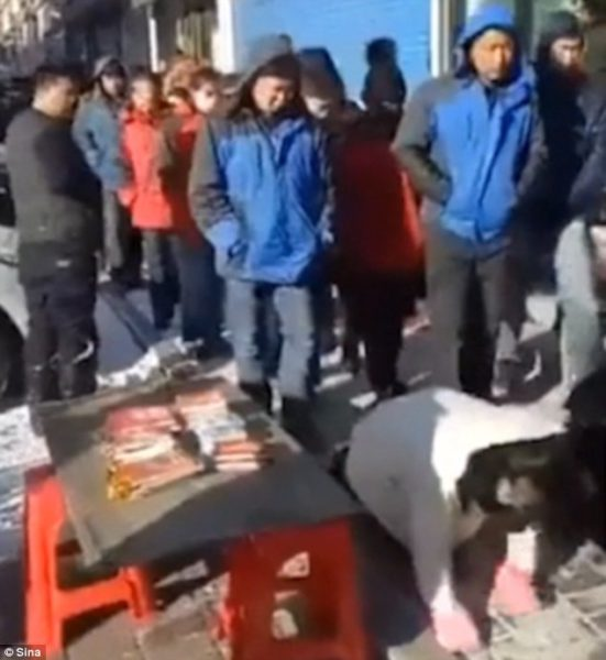 chinese business punishment boss crawl in snow