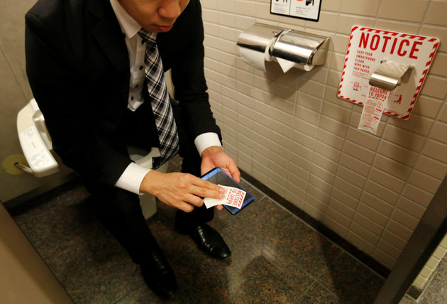 Smartphone toilet paper Japan bathroom Narita Airpor