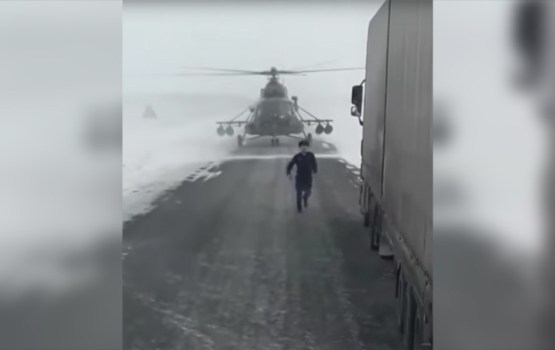 Soviet-Era Military Helicopter Lands on Highway To Ask Trucker For Directions