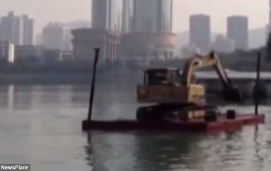 Construction Worker Unsuccessfully Tries To Row His Excavator Across River
