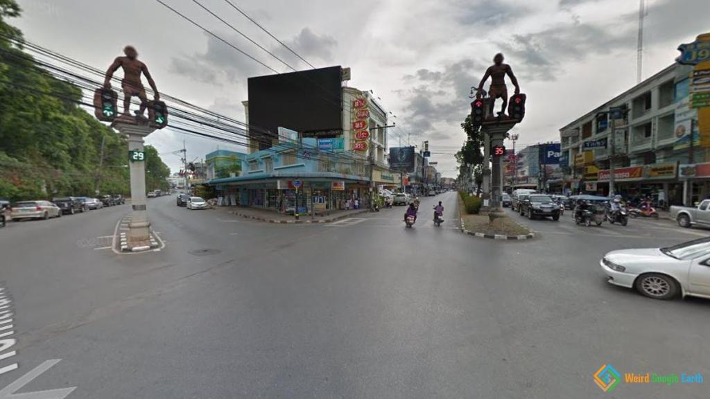 Caveman Holds Traffic Lights, Krabi, Thailand