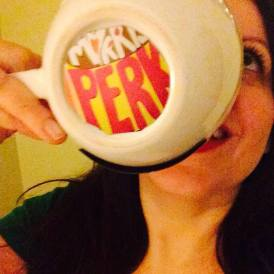 Lovie Pignata drinking having her cup of coffee out from her custom mug / Image Credit Lovie Pignata