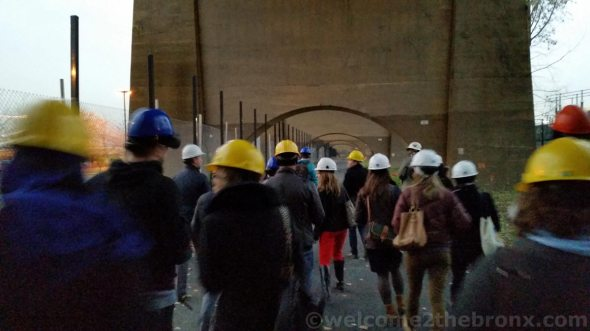 Tour participants walked along the 1/4 mile path under the Amtrak bridge leading to the bridge connecting The Bronx with Randall's Island
