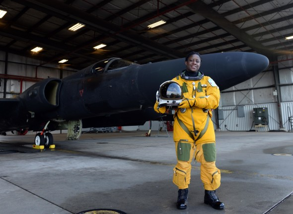 Lt. Col. Merryl Tengesdal stands in front of a U-2 Feb. 9, 2015, at Beale Air Force Base, Calif. Tengesdal is the only black female U-2 pilot in history. Tengesdal is the 9th Reconnaissance Wing inspector general and a U-2 pilot. (U.S. Air Force photo/Senior Airman Bobby Cummings)