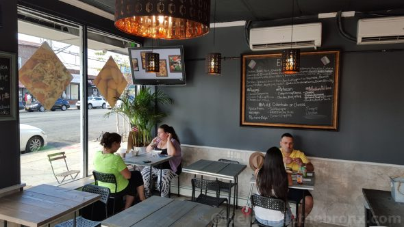Customers enjoy a great meal in a small, quaint, yet modern atmosphere that feels like you're in someone's dining room.