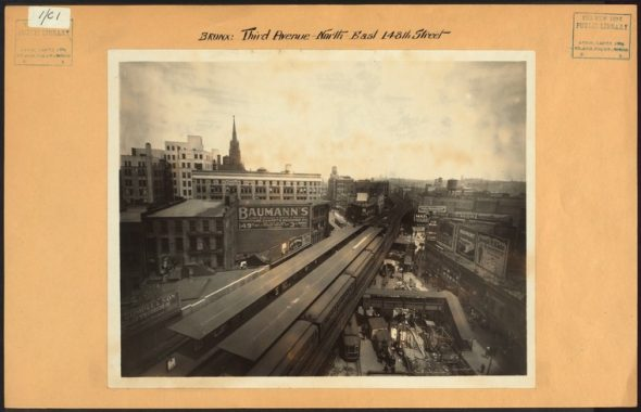 """Third Avenue at 148th Street in The Hub looking north towards Melrose in 1926. Many of the buildings in this image still stand including Immaculate Conception Church (minus its steeple). Long gone is the Third Avenue El which left a gaping transit desert in Morrisania and other points north / Image Credit: Irma and Paul Milstein Division of United States History, Local History and Genealogy, The New York Public Library. """"Bronx: 3rd Avenue - 148th Street (East)"""" The New York Public Library Digital Collections. 1926."""