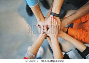 People with there hands together in a circle
