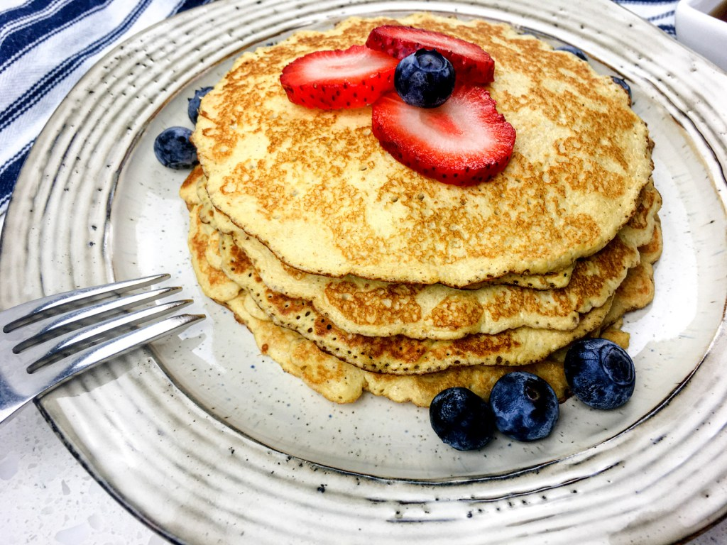 Creme cheese pancakes with berries on a plate