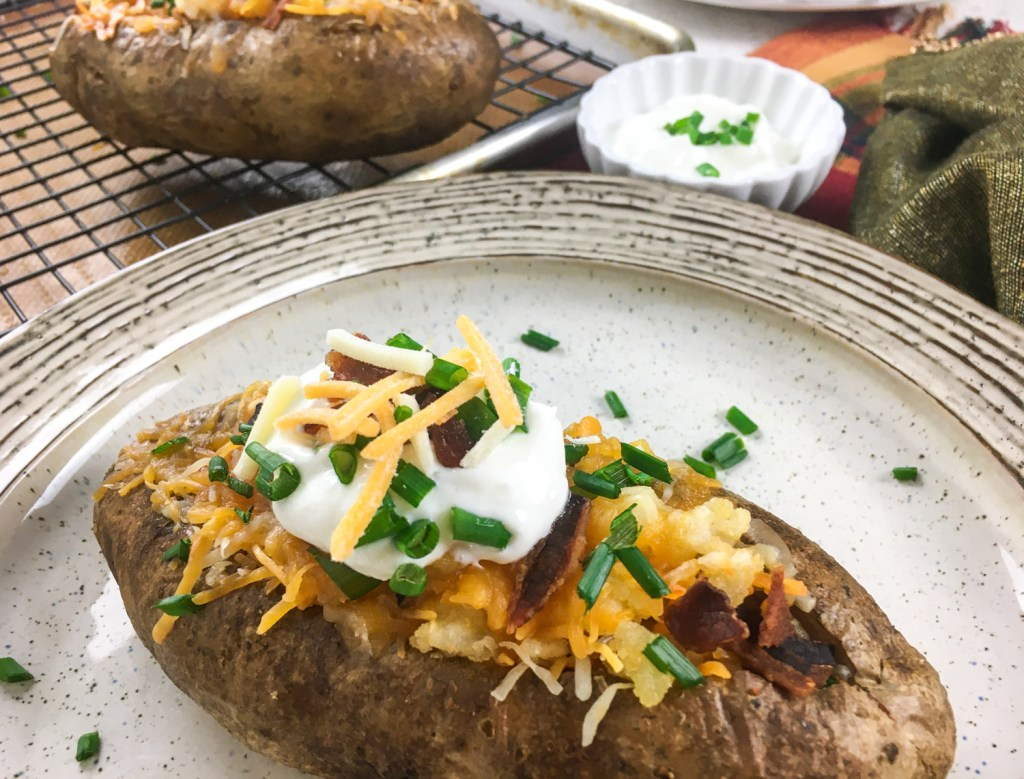 Loaded Stuffed Baked Potatoes on a plate.