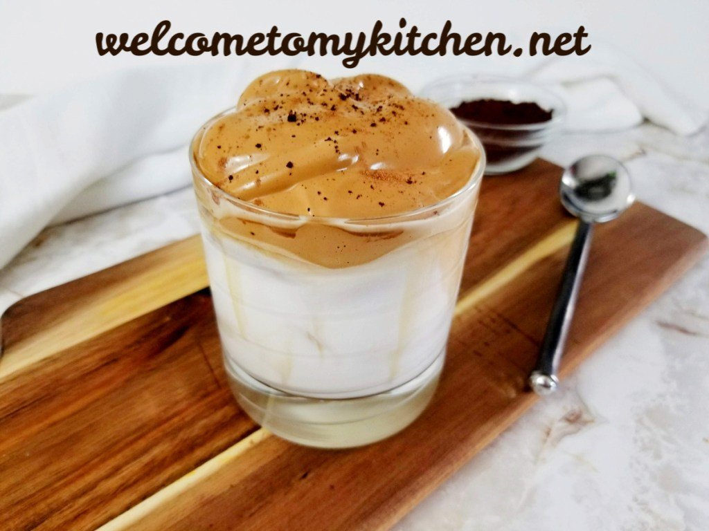 Caramel Vanilla Dalgona Coffee in a glass with milk