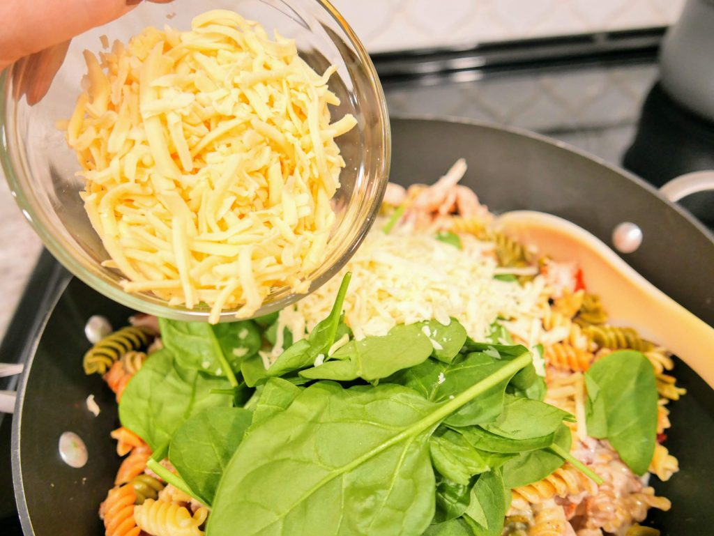 Ingredients for Tuscan Chicken Pasta in a skillet