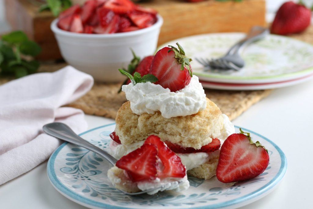 Homemade Strawberry Shortcake with strawberries on a plate.