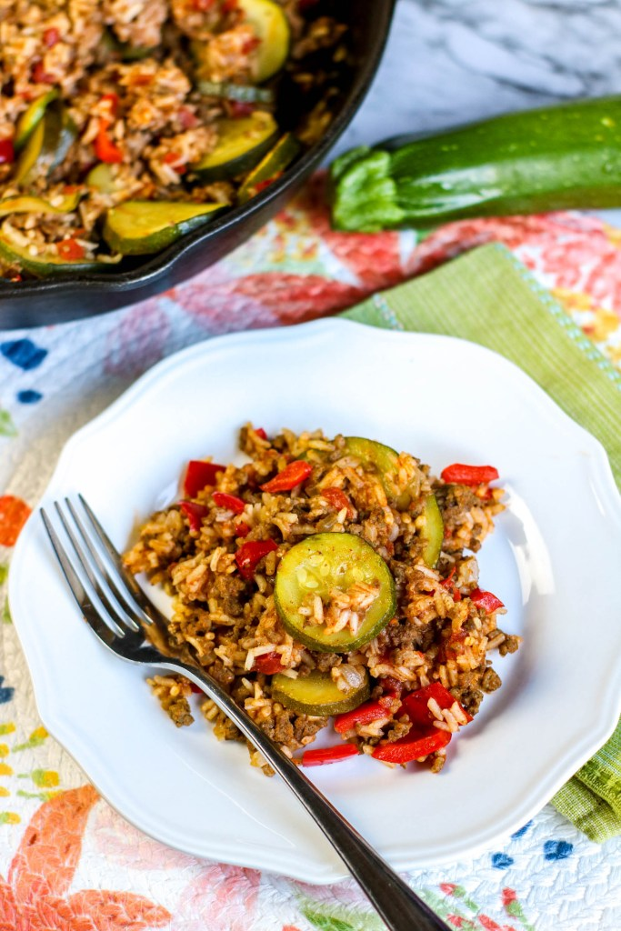 Zuchinni Ground Beef Rice Skillet on a plate with a fork