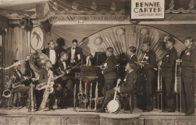 1928 – Bennie Carter & His Savoy Playboys on the Savoy Ballroom bandstand. Source: Biblio.com