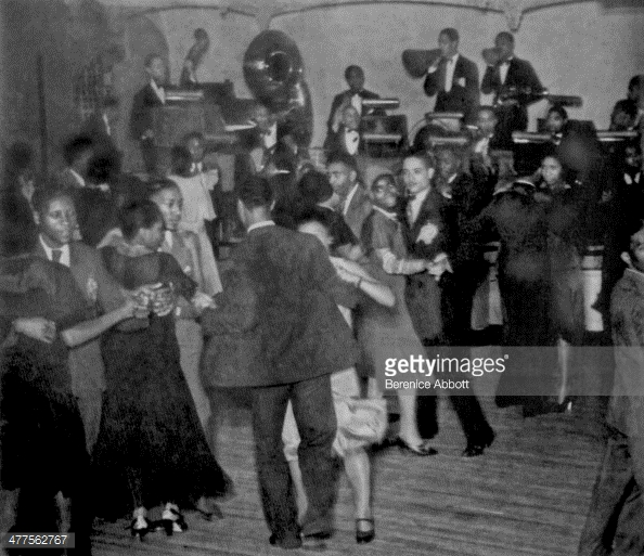 c.1930 – Dancers at the Savoy Ballroom with Chick Webb & His Orchestra on the bandstand.  Source: photograph by Berenice Abbott, Getty Images.