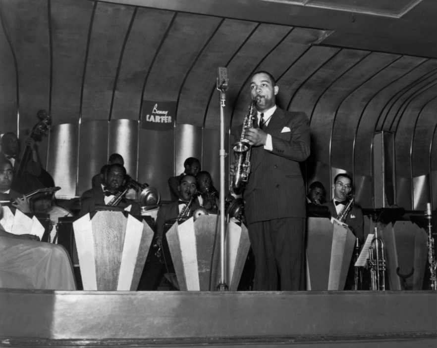 1939 – Benny Carter & His Orchestra at the Savoy Ballroom. Musicians: Ulysses Livingston, Hayes Alvis, Joe Thomas, Jesse Powell, Lincoln Hills, Jimmy Archey, Tyree Glenn. Source: Collection F.Driggs, Magnum Photos (Reference PAR61867)