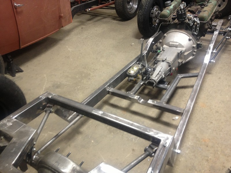 A modified triangulated rear four link.