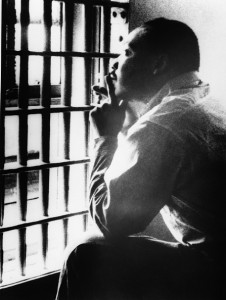 Civil rights leader Martin Luther King Jr. sits in a cell at the Jefferson County Jail in Alabama.