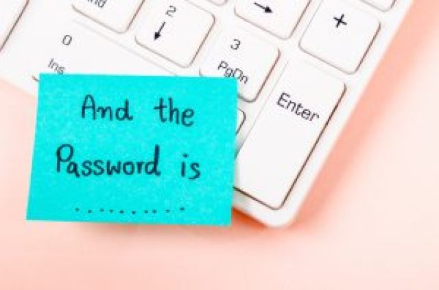 Cyber-resilient companies and password reminder on a sticky note
