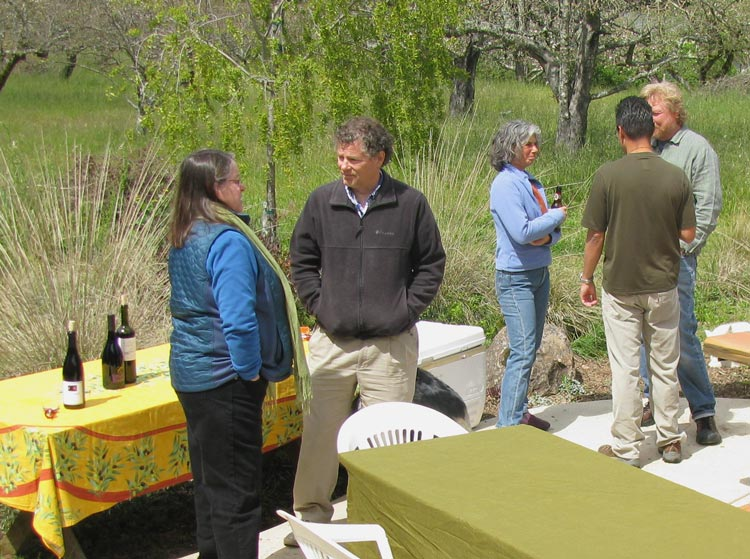 aronan and pk stand by the beverage table while friends of yesway's talk about tree-planting techniques.