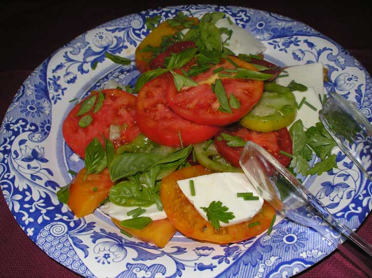 A gorgeous salad of heirloom tomatoes, basil and fresh mozzarella, courtesy of ronks