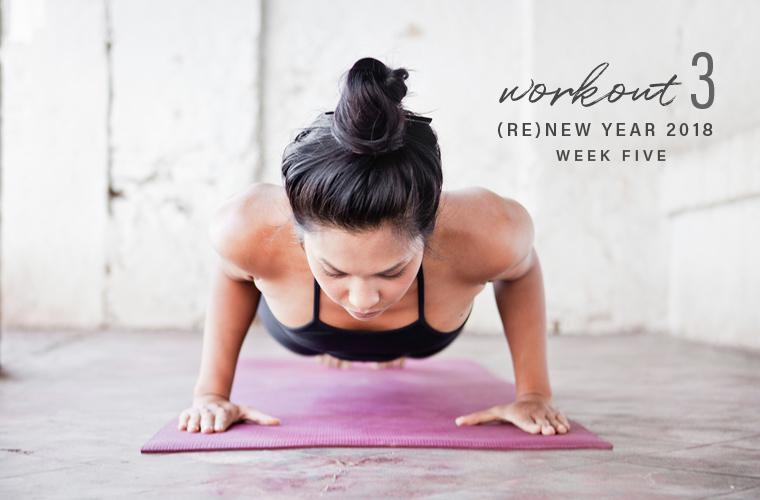 Woman doing push-up on yoga mat