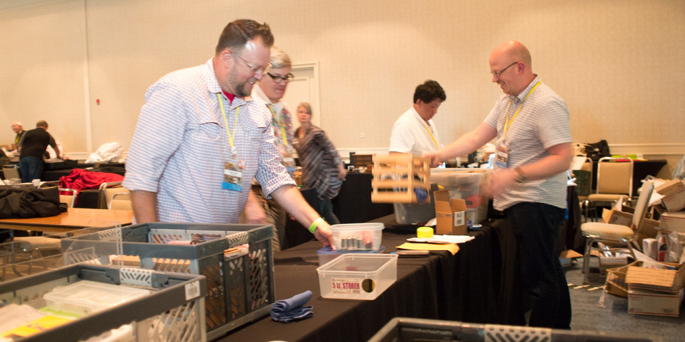 Brady Dowdy, Mike Vanness and Matt Armstrong packing up the Vanness Pens booth as the show winds down