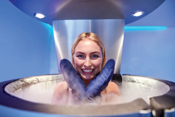 Cute young woman in cryosauna booth