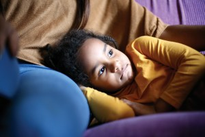Cute African girl napping.