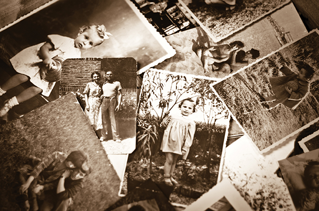 A pile of old black and white photographs