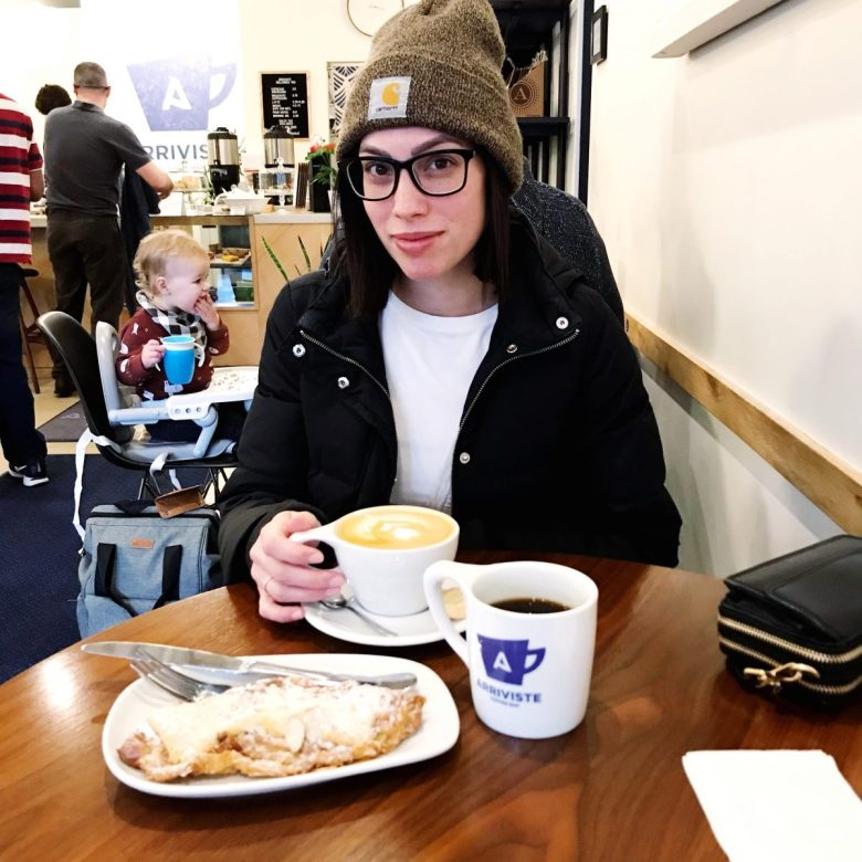 Childbirth Story featured by top US lifestyle blogger Wellesley & King; Image of a woman at a coffee shop.